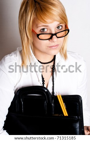 young businesswoman with portfolio on white background - stock photo