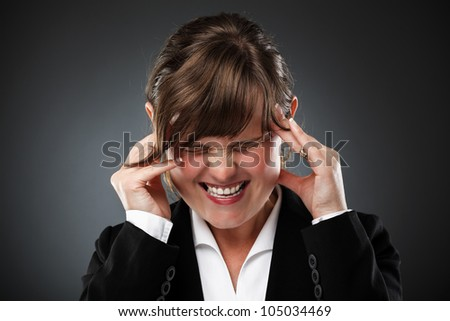 Young businesswoman with strong migraine