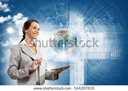 Young businesswoman with tablet pc in hands. Globalization concept. Elements of this image are furnished by NASA