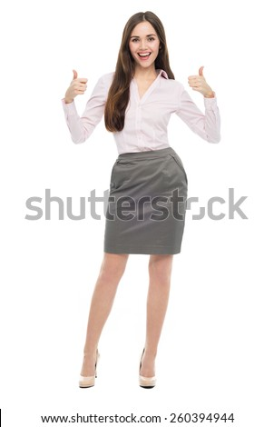 Young businesswoman with thumbs up  - stock photo