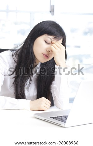 Young businesswoman with tired eyes - stock photo