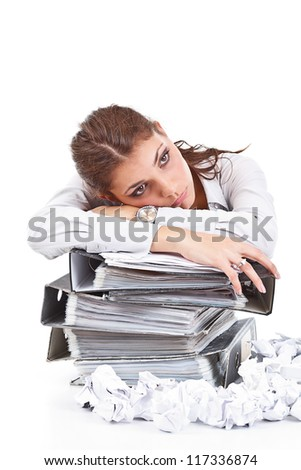 Young businesswoman with tons of documents - stock photo