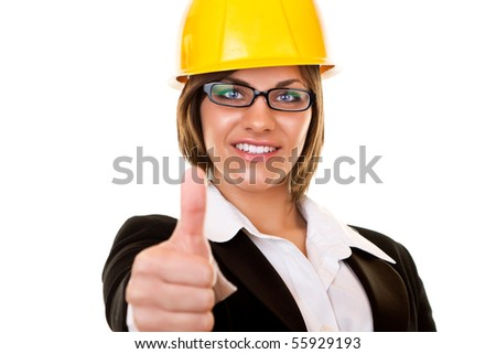 young businesswoman with yellow helmet holding thumb up