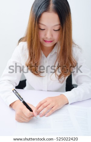 Young businesswoman working at desk.