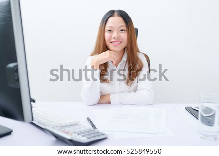 Young businesswoman working at her workplace.