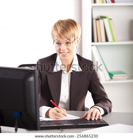 Young businesswoman working at the computer - stock photo