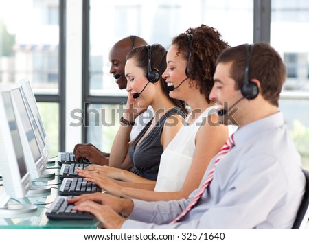 Young businesswoman working in a call center with his colleagues - stock photo