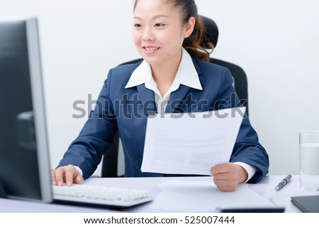 Young businesswoman working on computer.