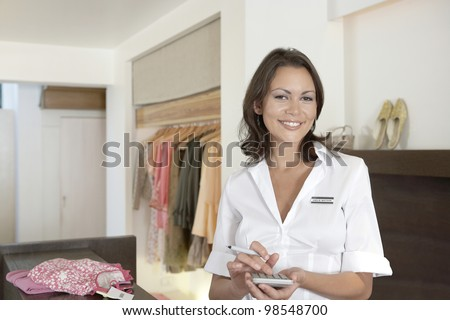 Young businesswoman working on her business finance, smiling. - stock photo