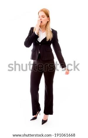 Young businesswoman yawning - stock photo