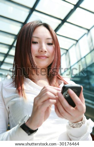 young businesswomen working with mobile phone