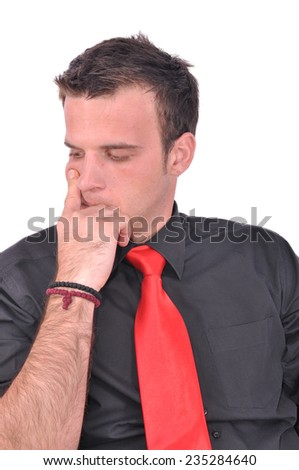 Young bussinesman is thinking and looking down - stock photo
