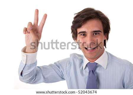 Young bussiness man with arm raised in victory sign, on white background. Studio shot - stock photo