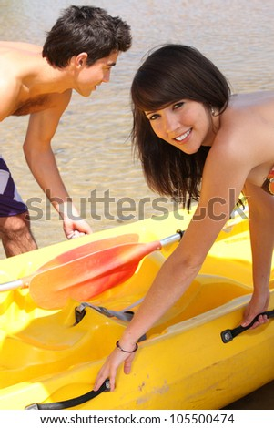 Young canoeing - stock photo