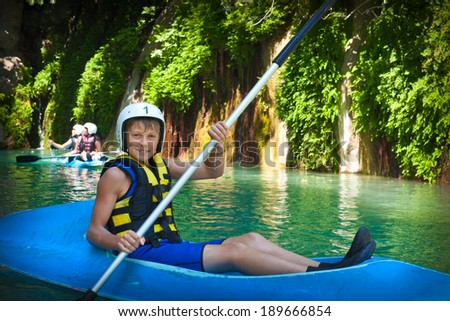 Young canoeist who took the first place in traditional junior competitions - stock photo