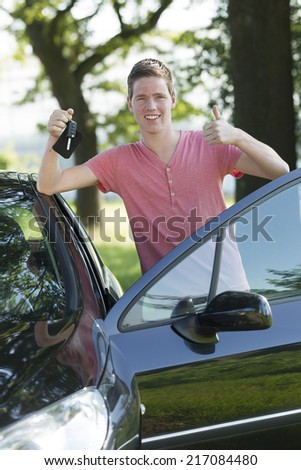 Young car owner shows his proud