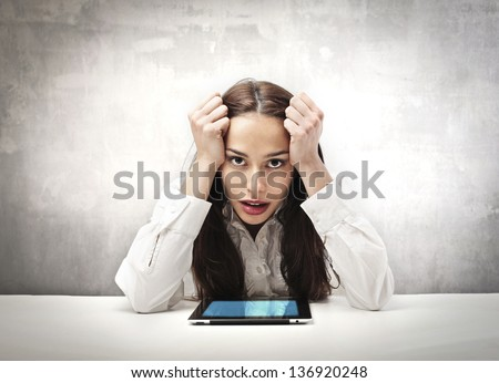 young career woman in trouble with tablet - stock photo