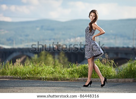young carefree woman at the street in city - stock photo