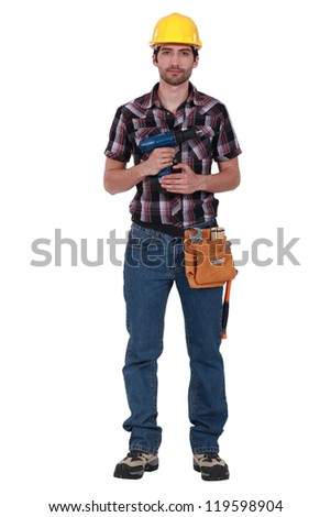 Young carpenter holding cordless drill - stock photo