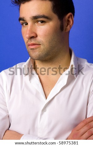 Young casual atractive man, on a blue background