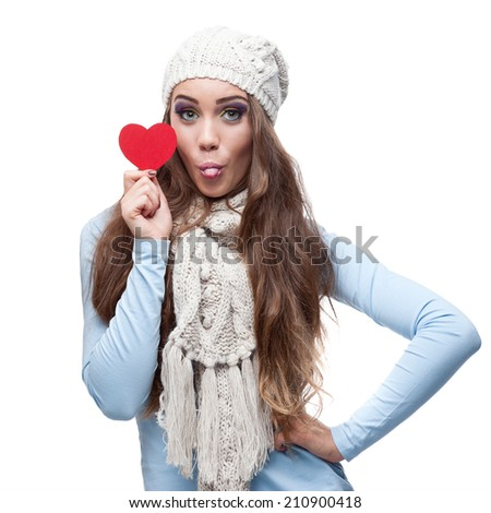 young casual caucasian brunette woman in winter clothing holding red heart isolated on white - stock photo