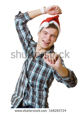 young casual dancing man in a santa hat - stock photo