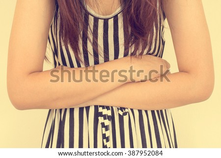 Young casual girl woman is having stomach ache. Vintage filtered image. - stock photo
