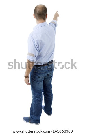 young casual man from the back pointing, full body, isolated