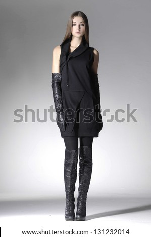 young casual man full body fashion woman in gloves posing - stock photo