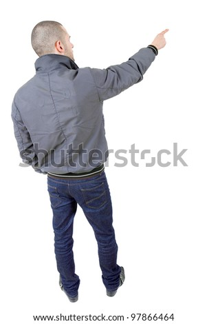 young casual man full body pointing, in a white background - stock photo