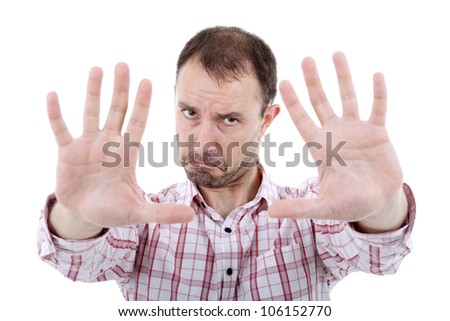young casual man full body pointing, isolated on white - stock photo