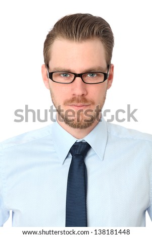 Young casual man in a blue shirt wearing glasses. White background. - stock photo