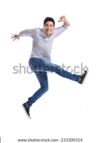 young casual man jumping for joy - stock photo