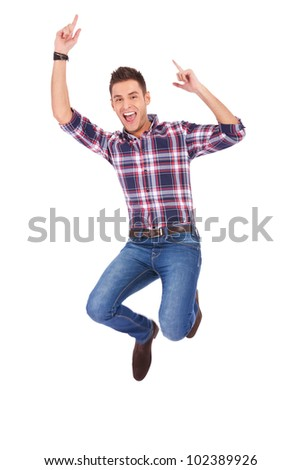 young casual man jumping joy on stock photo royalty free