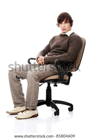 Young casual man on a chair, isolated on white - stock photo