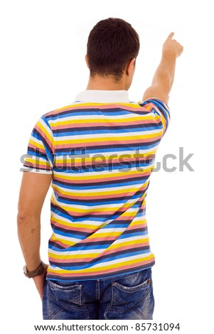 Young casual man pointing against white background - stock photo