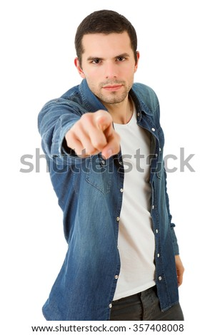 young casual man pointing, isolated on white - stock photo