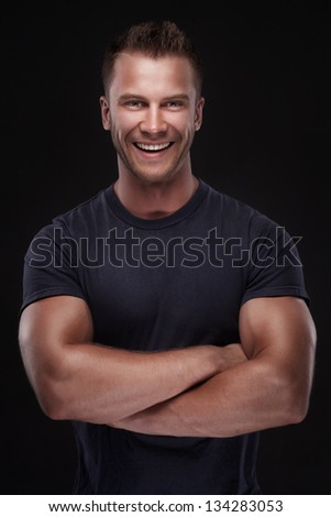 young casual man portrait isolated on black background