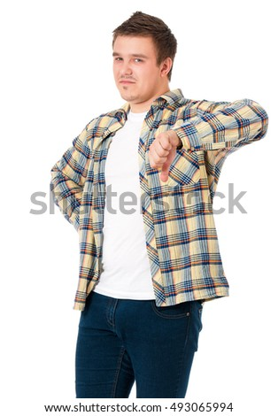 Young casual man show the thumb down negative hand sign, isolated on white background. Disappointed handsome guy making bad sign and making sad a face.