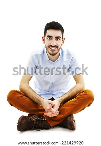 Young casual man sitting on floor. Isolated on white background - stock photo