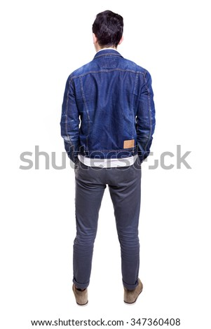 Young casual man standing from back, isolated on white background