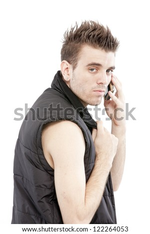 young casual man talking on the phone isolated on white background