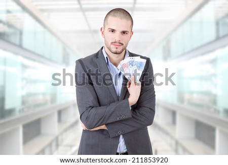 young casual man with lots of money at the office - stock photo