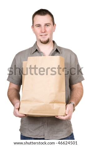 young casual man with shopping bag. over white background
