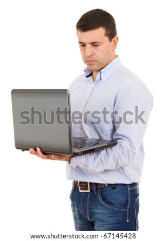 Young casual man working with a laptop. Isolated on white.