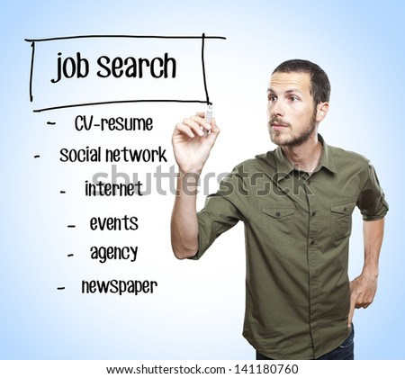 young casual man writing a job search diagram  on glass board