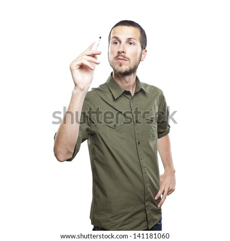 Young casual man writing something on glass board with marker