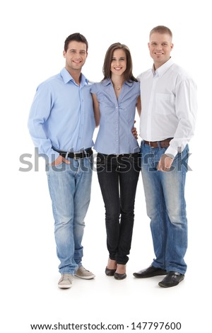 Young casual office team standing together, smiling at camera, cutout portrait. - stock photo