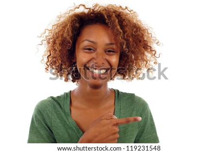 Young casual smiling black woman pointing sideways isolated over white - stock photo