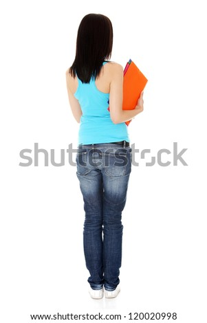 Young casual student woman from behind, isolated on white - stock photo